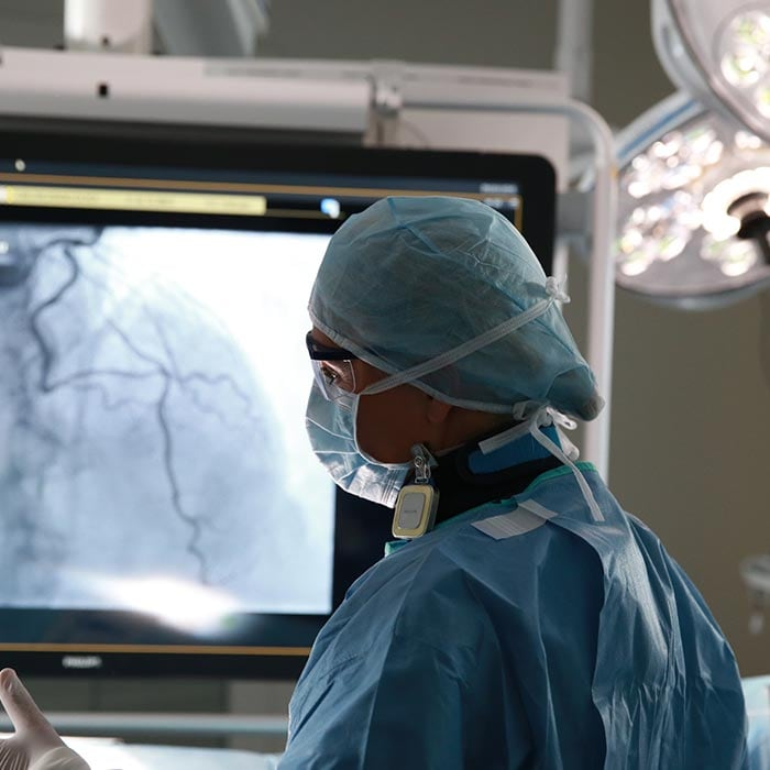 surgeon looking at imaging